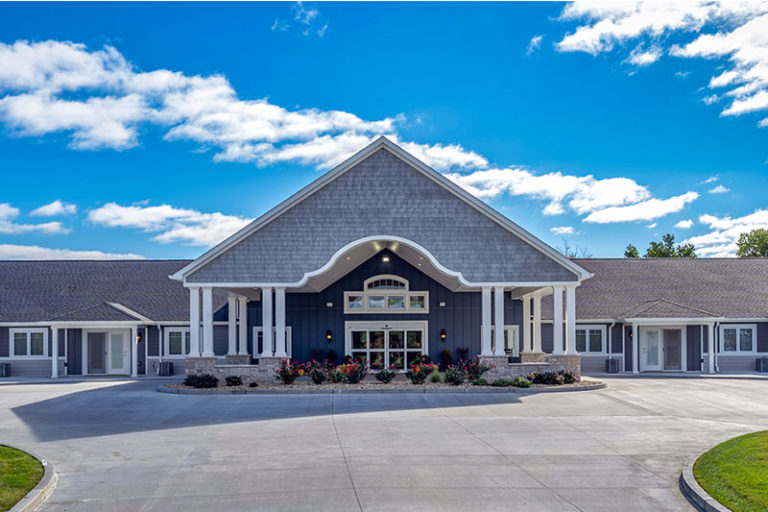The Villas of Holly Brook & Reflections Memory Care entrance on Hedley Road in Springfield, IL.